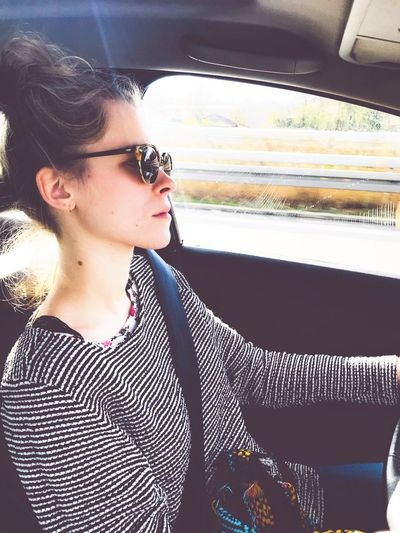 Car Car Interior Young Adult One Person Transportation Real People Young Women Day Close-up Outdoors Sky Adult People On The Way Roadtrippin' Driving Around Sunlight Roadtrip On The Move Streetlife Fashion Woman Power Taking Care Of Business Sunglasses Highways&Freeways