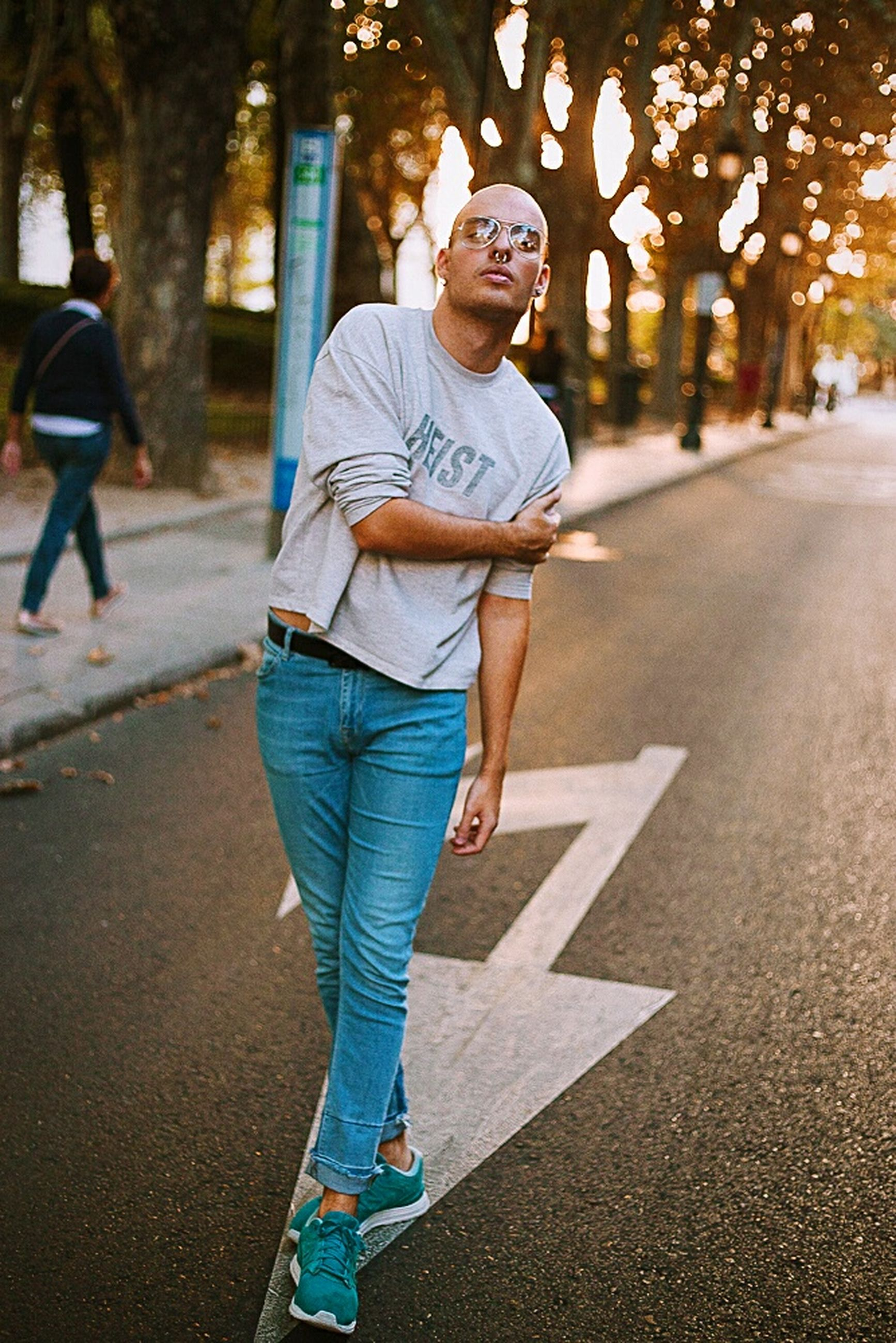 casual clothing, full length, one person, jeans, lifestyles, street, road, mature adult, front view, outdoors, mature men, adult, adults only, people, one man only, only men, men, day, portrait, city