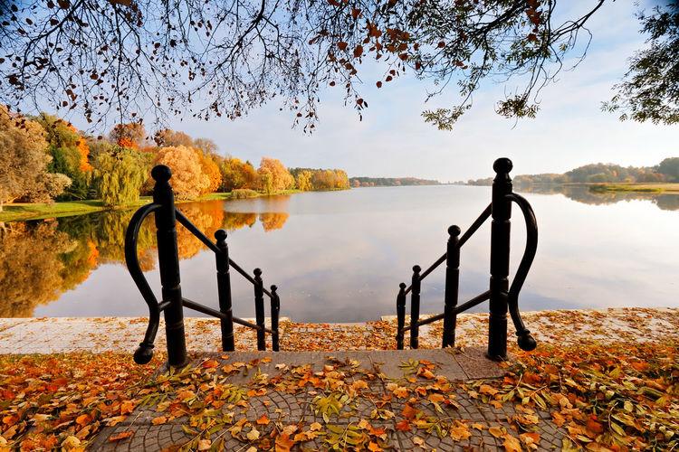 Men standing on lake during autumn