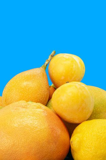 Close-up of oranges against blue background