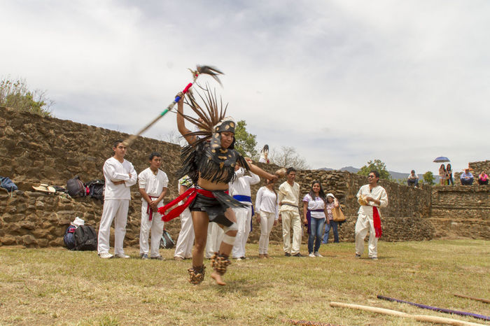 A ballerina practicing a pre-Hispanic dance in the Tinganio archaeological site, in the village of Tingambato, during the welcoming ceremony for the spring. Dance Dancer Full Length Grass Indigenous  Large Group Of People Lifestyles Person Pre-Hispanic Traditions Woman