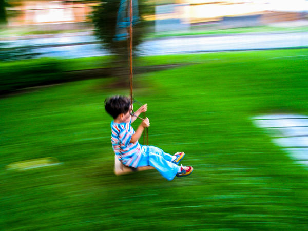Happy Blurred Motion Boys Childhood Day Full Length Fun Fuunymomemt Grass Motion One Boy Only One Person Outdoors People Playing Real People Side View Water