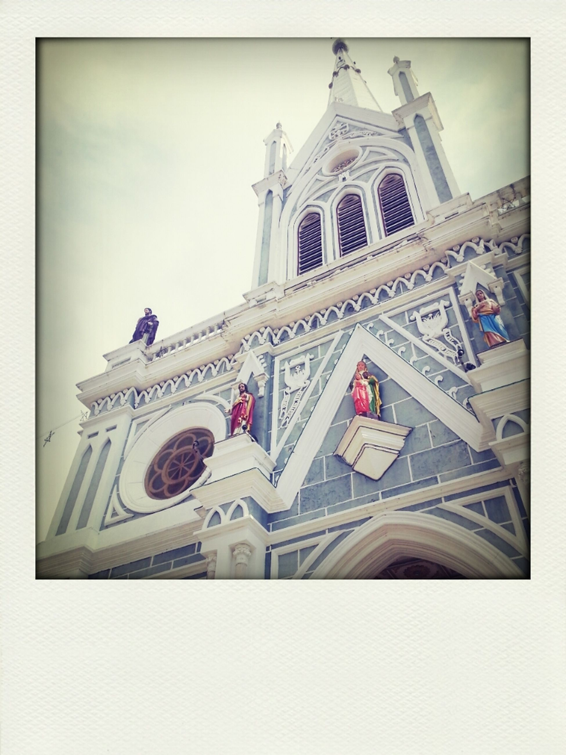 architecture, built structure, building exterior, transfer print, religion, place of worship, low angle view, church, spirituality, cathedral, famous place, auto post production filter, international landmark, travel destinations, capital cities, sky, tower, travel