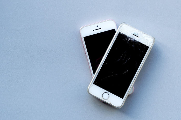Low angle view of smart phone against white background