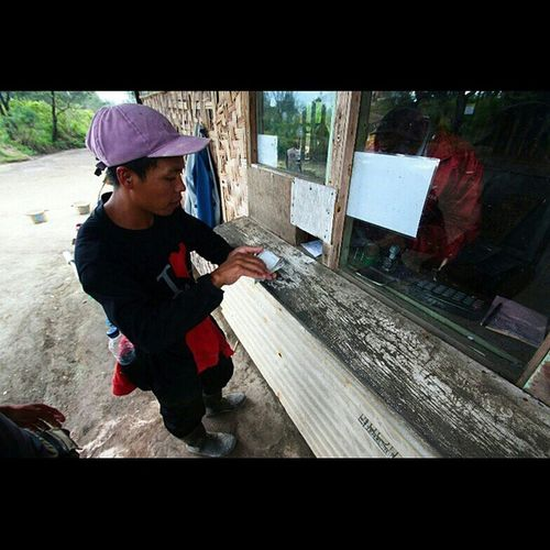 20 . In a booth at the other side of the house, Muchtar, one of the miners get his paid. Today the men, 29 years, gained no more than 65 kilos while the sulfur price was IDR 780 per kilos that time. IJEN, A HARDWORK STORY. Ijen Banyuwangi Explorebanyuwangi Eastjava Exploreeastjava Explorejava Human Life Hardwork Photostory Photoessay INDONESIA Exploreindonesia Instanesia Indonesia_photography Describeindonesia ManaIndonesiamu Instanusantara Challenge. @manaindonesiamu @instanusantara JelajahIndonesiaku 1000kata