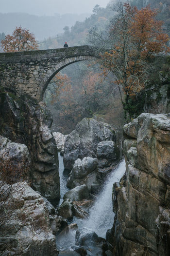 National Park Peneda Geres An Eye For Travel Business Stories Castle EyeEmNewHere FUJIFILM X-T2 Kornspeicher Lindoso Misarela Bridge National Park Nature Peneda-Gerês National Park Ponte De Misarela Portugal Shades Of Winter Architecture Beauty In Nature Bridge Bridge - Man Made Structure Connection Day Espigueiros Espigueiros Do Lindoso Explore Fujifilm Mountain Nature No People Outdoors River Rock - Object Scenics Sky Tree Water