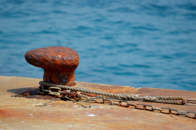 Close-up of rusty metal on pier