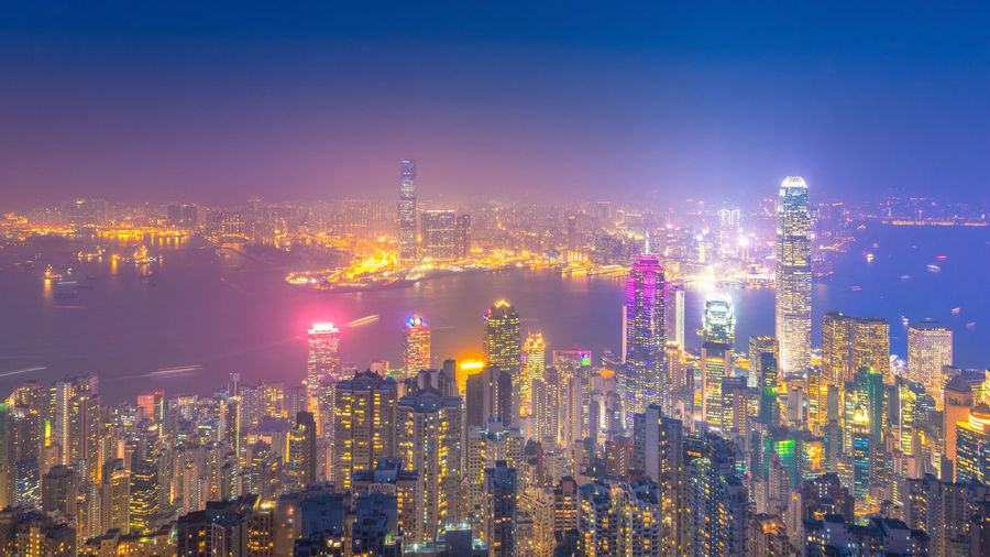 Famous cityscape view of Hong Kong skyline. ASIA City Cityscape HongKong Sightseeing Travel Twilight View Architecture Building Exterior Built Structure City Downtown District Dusk Illuminated Kowloon Landmark Landscape Night Outdoors Sky Skyscraper Tower Travel Destinations Urban
