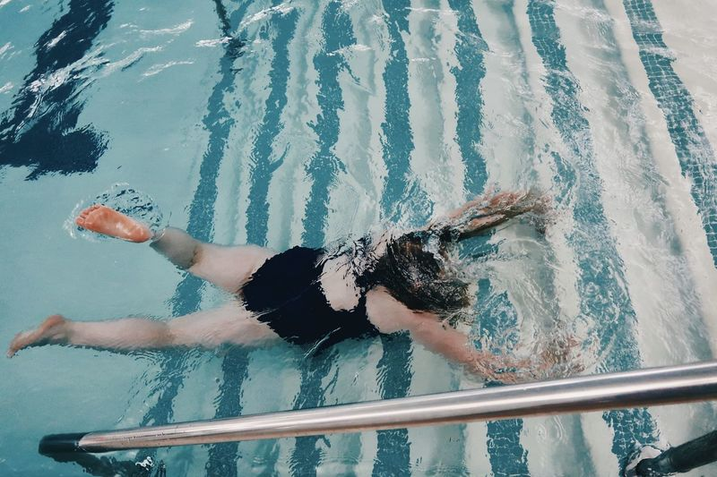 High angle view of woman in swimming pool