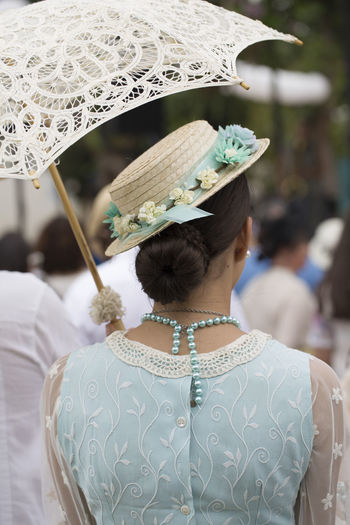 Rear view of a woman wearing an umbrella City Dress Elegant Galicia Hat Holiday Lugo SPAIN Sunny Clothing Costume Day Hat Lace Lifestyles One Person Outdoors Portrait Rear View Summer Umbrella Vertical