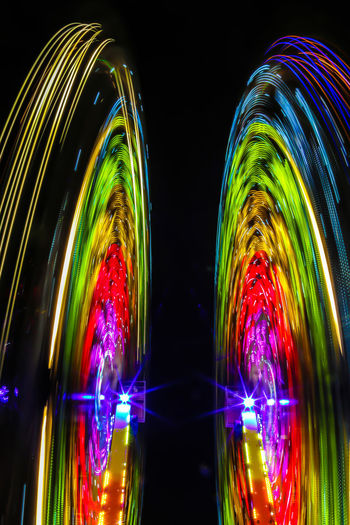 Digital composite image of illuminated lights against black background