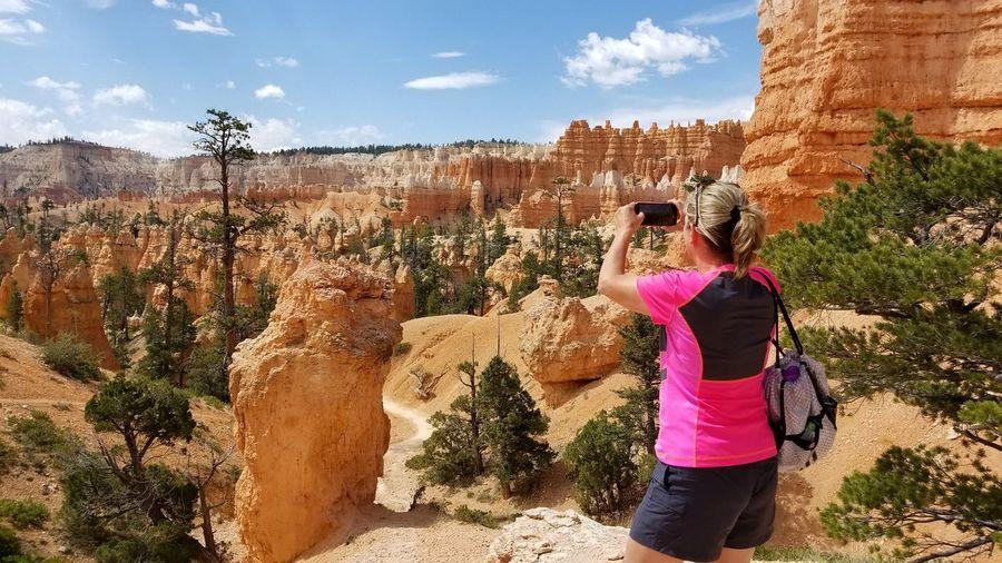 EyeEm Best Shots Women Rear View Standing Sky Landscape Rock Formation Desert Rock - Object Canyon Eroded Arid Arid Landscape Natural Landmark Rock Hoodoo