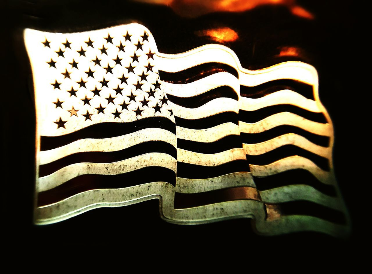 striped, no people, pattern, close-up, indoors, patriotism, studio shot, black background, day, stars and stripes