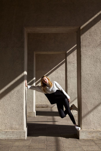 Side view of woman walking on staircase