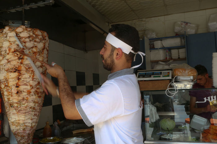 Inside Damascus, Syria. Baker - Occupation Bakery Beard Built Structure Chef Commercial Kitchen Damascus  Exterior Food And Drink Food And Drink Establishment Food And Drink Industry Life Men Normal One Person People Standing Sun Syria  Transport Waist Up War Working