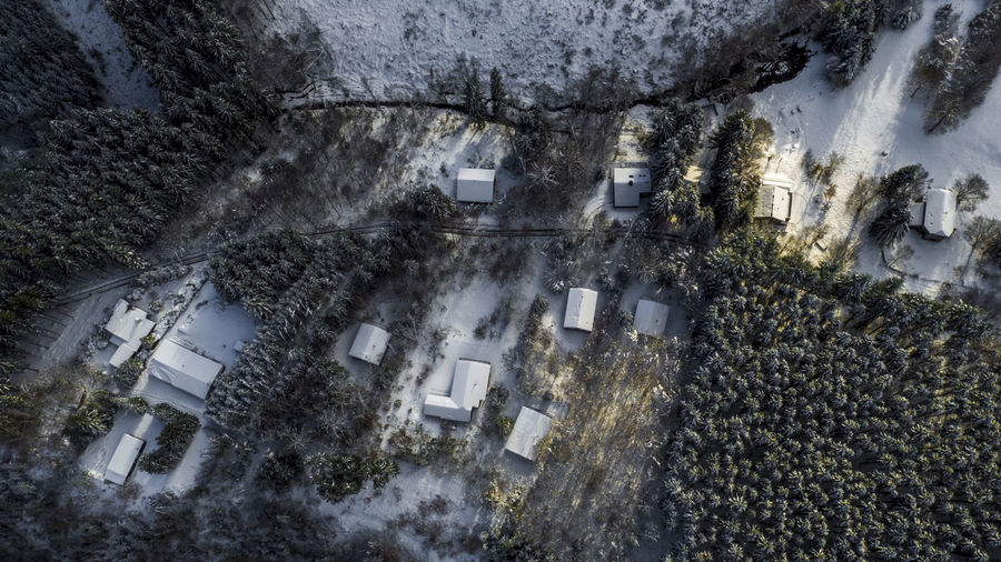 Topview aerial of houses covered in snow during a winter sunset in Belgium Aerial Shot Ardennes Belgium Drone  Winter Aerial Landscape Aerial View Architecture Dji Dronephotography Durbuy Europe Extreme Weather High Angle View Landscape Mavic Pro Nature No People Outdoors Snow Sunset Topview Tree Winter Woods