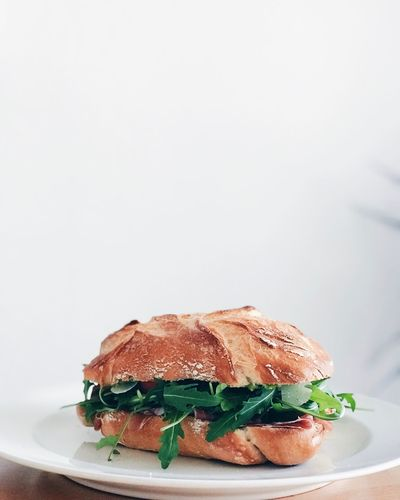 Italian Sandwich Comfort Foods Sandwich Time Arugula Food Food And Drink Copy Space Freshness Still Life Indoors  Unhealthy Eating Ready-to-eat No People Plate Sandwich Close-up White Background Bread Fast Food