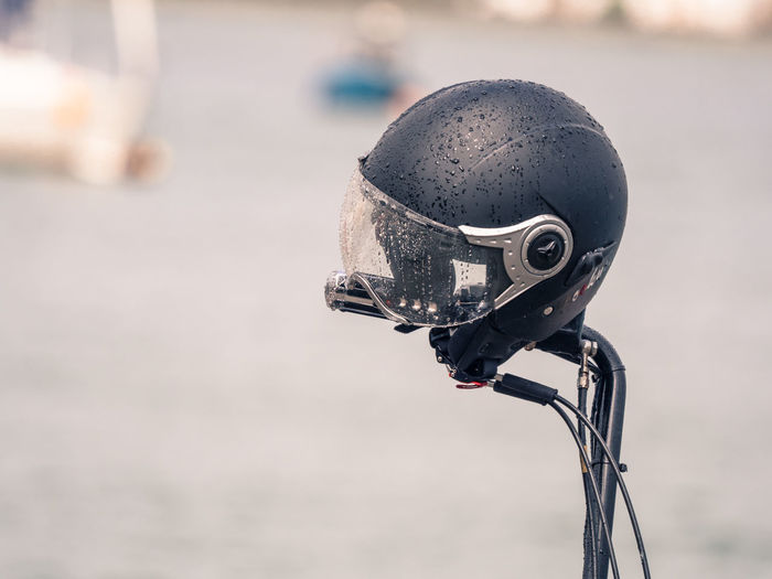 motorcycle helmet Motorcycle City Close-up Day Equipment Focus On Foreground Handlebar Land Vehicle Metal Mode Of Transportation Motorcycle Helmet Nature No People Old Outdoors Security Street Sunlight Technology Transportation