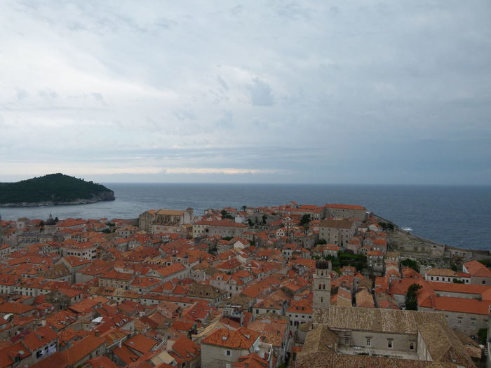 High angle view of buildings by sea against sky in old town