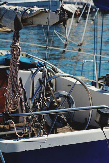 Steering wheel of sailboat in sea