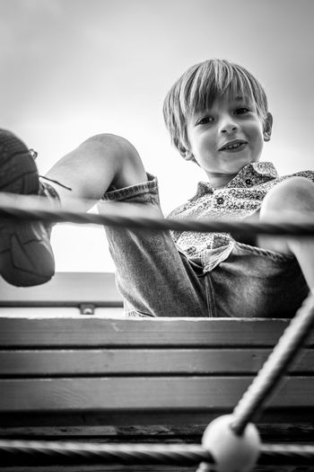 Portrait of boy playing against sky