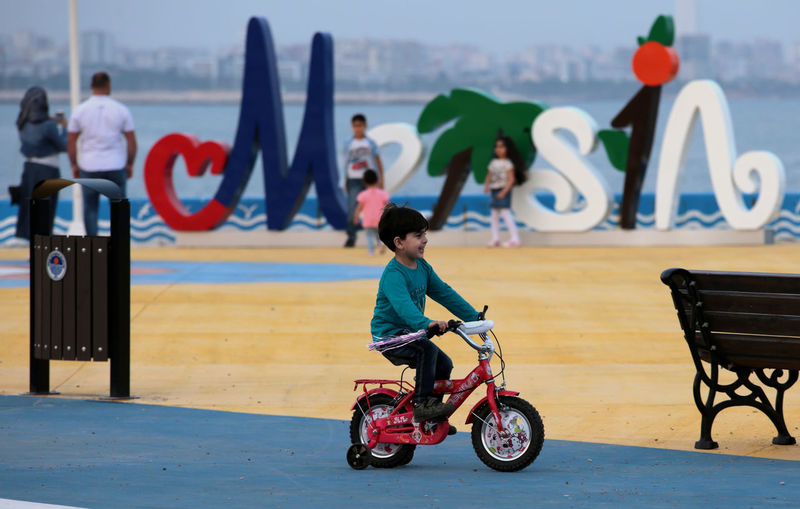 Side view of happy boy riding bicycles in park