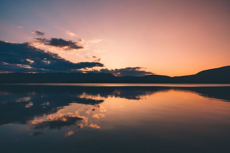 Mountains Sky Water Reflection Sunset Tranquility Scenics - Nature EyeEmNewHere Tranquil Scene Lake Tree Beauty In Nature Idyllic Nature Silhouette Plant Cloud - Sky Waterfront Orange Color No People Non-urban Scene