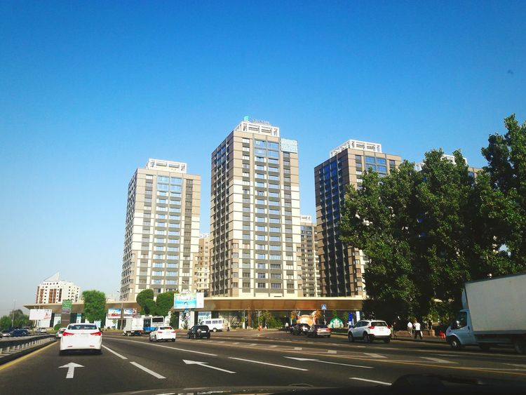 City Blue Skyscraper Architecture Clear Sky Urban Skyline Sky Outdoors Building Exterior Modern Cityscape Urban Road Business Finance And Industry No People Downtown District Day Almaty Kz MaximDtattoo Maximd Tattoo