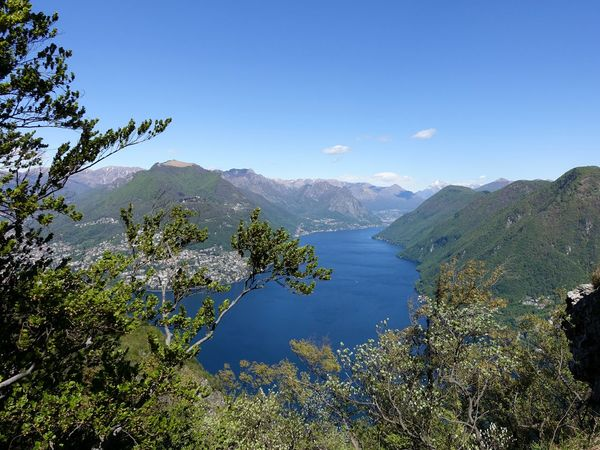 Beauty In Nature Hill Idyllic Lake Lake View Landscape Majestic Mountain Mountain Range Nature Plant Remote Sky Sky And Clouds Tranquil Scene Tranquility Tree Lugano, Switzerland San Salvatore Lake Lugano Lago Di Lugano  The Great Outdoors With Adobe
