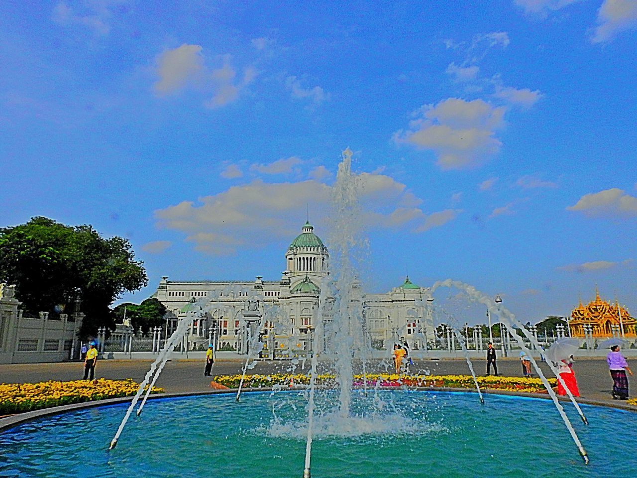 water, built structure, architecture, building exterior, sky, cloud - sky, travel destinations, nature, travel, religion, place of worship, day, tourism, building, dome, spirituality, belief, incidental people, waterfront, outdoors, swimming pool