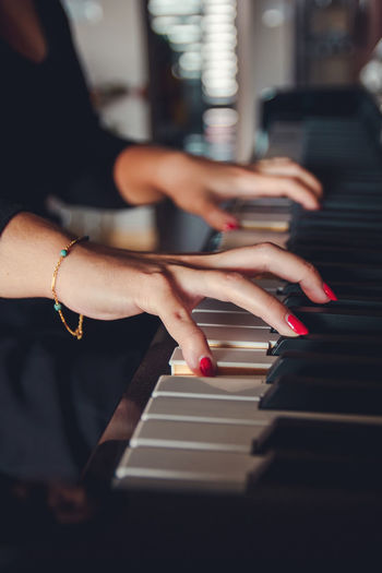 Lady hands on piano