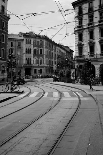 Architecture Building Exterior Built Structure Cable City Clear Sky Day EyeEm Best Shots EyeEmBestPics Italy Land Vehicle Milan Mode Of Transport Outdoors Rail Transportation Railroad Track Real People Road Sky Street The Way Forward Tramway Transportation The Architect - 2017 EyeEm Awards