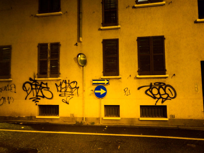 Graffiti Road Sign Window Building Exterior Architecture Built Structure Outdoors Street Art Day Yellow City