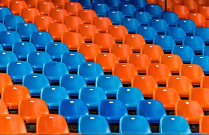In A Row Orange Color Multi Colored Education Large Group Of Objects Seat Red Backgrounds Stadium Lecture Hall Day No People Outdoors Football Football Stadium Blue