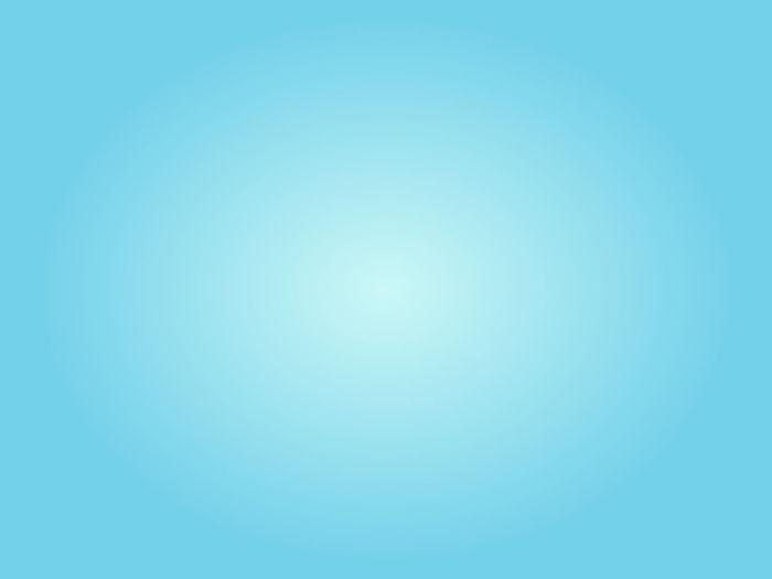 Defocused image of tree against blue sky