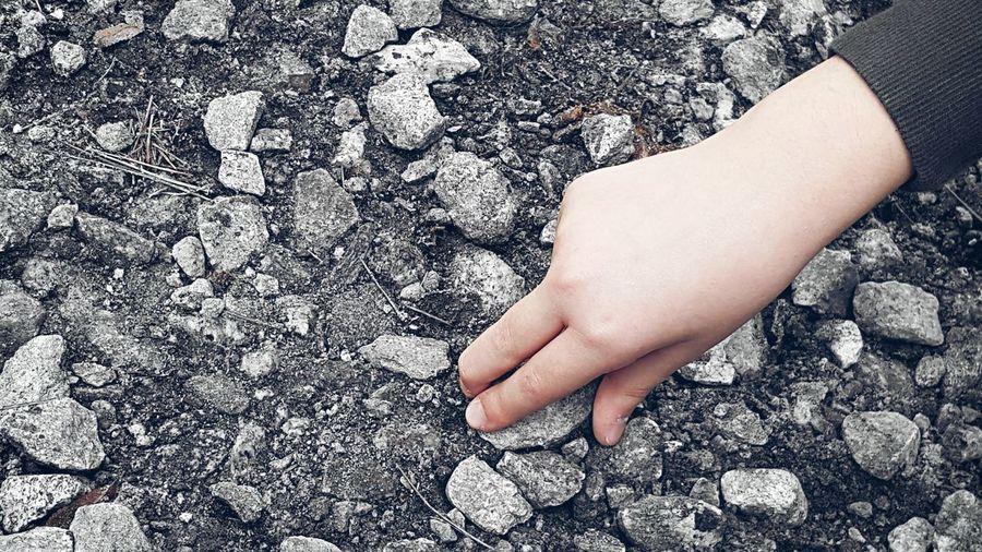Cropped Hand Picking Rock