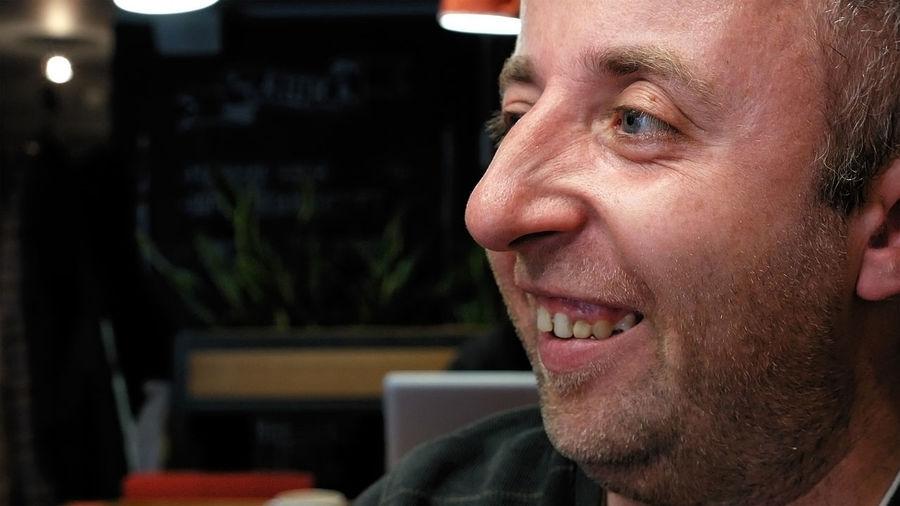 Close-up of smiling man looking away