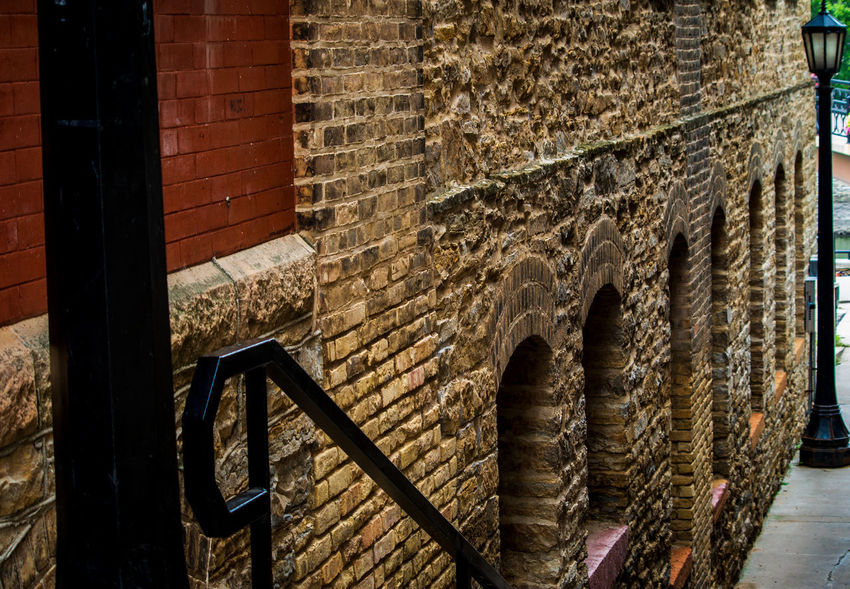 Alleyway Architecture Art And Craft Brick Brick Wall Building Building Exterior Built Structure Creativity Day History No People Old Outdoors Pattern Stone Wall Wall Wall - Building Feature Wood - Material