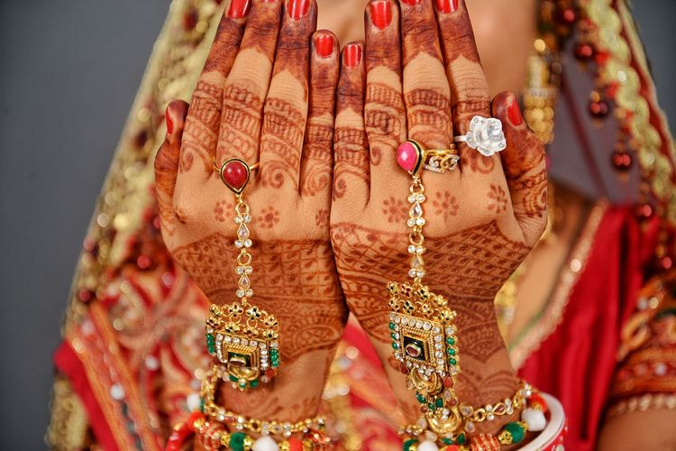 Close-Up Of Bride With Henna Tattoo