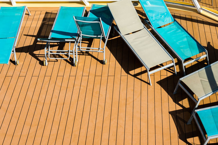 Cruise Ship Deckchairs Holiday Relaxing Travelling Vacations Absence Beach Chairs Blue Chair Day Deckchair Go-west-photography.com Nature No People Outdoors Pool Pooltime Shadow Sky Sunlight Table Travel Destinations Wood - Material