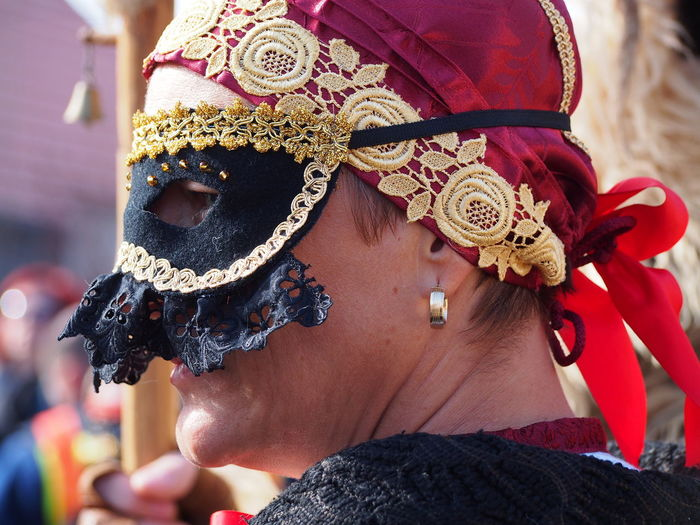 Close-up of woman wearing masquerade mask