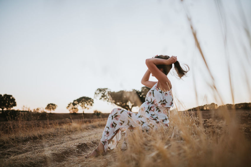 Pregnant Pregnancy Pregnant Phtography One Person Land Real People Field Nature Casual Clothing Enjoyment Young Adult Hairstyle Child Lifestyles Leisure Activity Mother Mother & Daughter Portrait Sky Full Length Dress