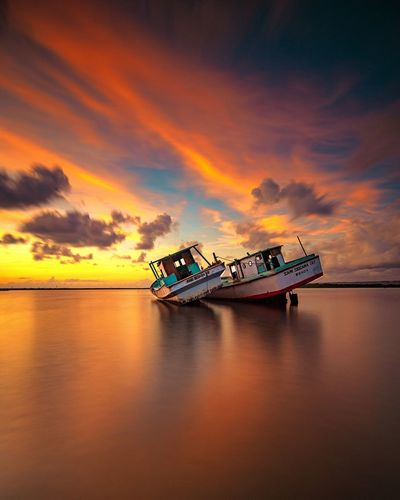 Always together Water Sea Transportation Reflection Cloud - Sky Sunrise And Clouds Sunrise Clouds And Sky Travel Destinations Bali Landscape Landscape_Collection Landscape_photography EyeEmNewHere Morning Light Morning Sky Long Exposure Sunshine Horizon Over Water Outdoors Day Paint The Town Yellow
