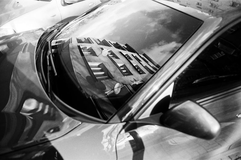 ANALOG Ilford Pan 100 The Week on EyeEm Light And Shadow Analogue Photography Nikonphotography Street Photography Bnw Capture The Moment Film Photography Black And White Car Motor Vehicle Mode Of Transportation Transportation Land Vehicle Reflection Glass - Material No People Close-up Day Side-view Mirror Outdoors Window Shiny Wealth Windshield Vehicle Hood High Angle View Luxury Vehicle Mirror Chrome