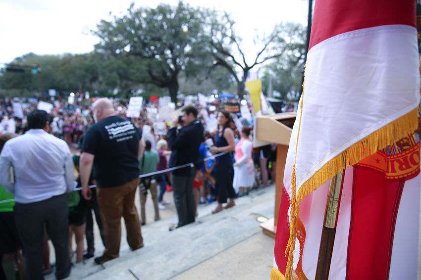 TALLAHASSEE, FL - FEBRUARY 21, 2018: Parkland students and supporters rally at Florida State Capitol for gun control. Activists and students from Marjory Stoneman Douglas High School attend a rally at the Florida State Capitol building to address gun control on February 21, 2018 in Tallahassee, Florida. In the wake of deadly mass shooting that left 17 people dead, thousands of supporters joined the Parkland students to call for gun reform. Activists Florida State Capitol Gun Lobby Marjory Stoneman Douglas High School Tallahassee, FL Brady Foundation Florida Gun Control Gun Laws Lawmakers National Rifle Association Never Again Rally Neveragain Nra Parkland Politic Political Protect Kids Protestor Protestors Rally Shooting Tallahassee Capitol Building Tallahassee Historic Museum Tallahassee History Museum