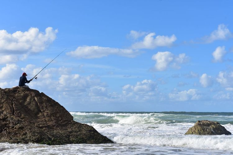 Beauty In Nature Burleigh Heads Burleigh Heads, Australia Cloud - Sky Fisherman Fishing Rod Horizon Over Water Nature One Person Rock - Object Scenics Sea Sky Tranquil Scene Tranquility Travel Travel Destination Travel Photographer Travel Photography Water Waves Waves And Rocks Waves, Ocean, Nature