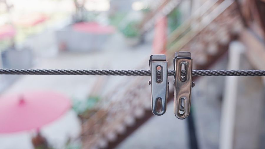 couple clips Decoration Couple Clip Focus On Foreground Metal Close-up Hanging No People Outdoors Padlock Day Architecture