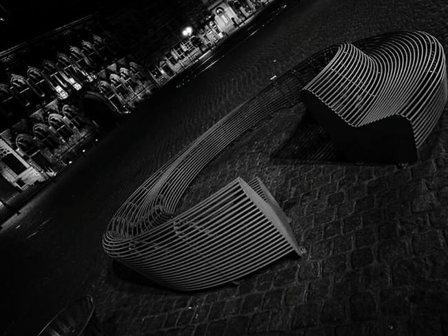 High Angle View City Outdoor Photography Night Lights Black & White Metallic Bench Modern Design Old-fashioned Old Buildings Cobblestone Streets Round Shape EyeEm EyeEm Gallery Architecture Design Constrast Black And White Usual Object High Angle View City Cityscapes Full Frame Focus On Foreground No Edit/no Filter