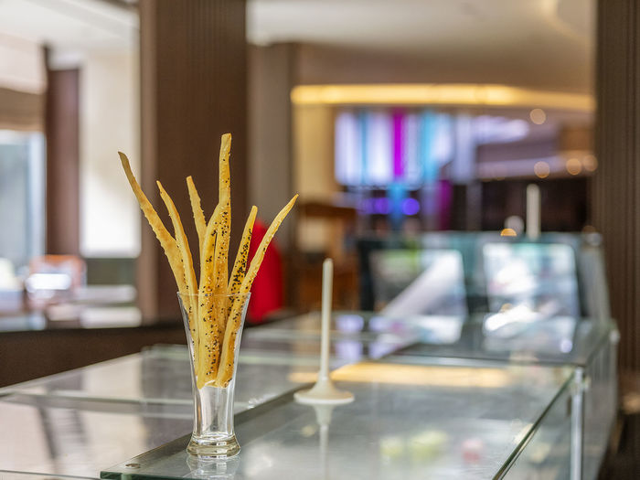 A home-made cheese stick decorated in the glass located in Bandung, Indonesia Dinner Breakfast Food Crust Morning Christmas Cream Cheesesticks Cheese Dining Cooked Cuisine Meal Puff Pastry Sweet Sugar Baked Pastry Dessert Homemade Bakery Snack Cake Eat Bread