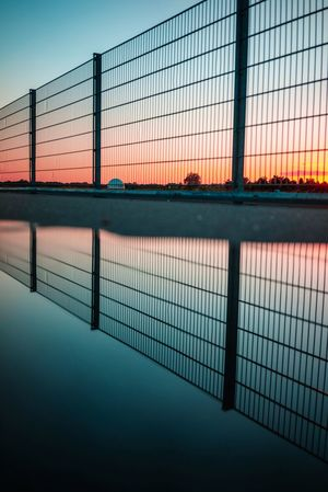 Sunset Water Sky Nature Reflection Fence No People Built Structure Architecture Barrier Boundary Waterfront Safety Outdoors Security Cloud - Sky Dusk Sport Protection Swimming Pool
